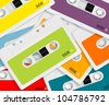 set of colored audio cassettes background. - stock photo