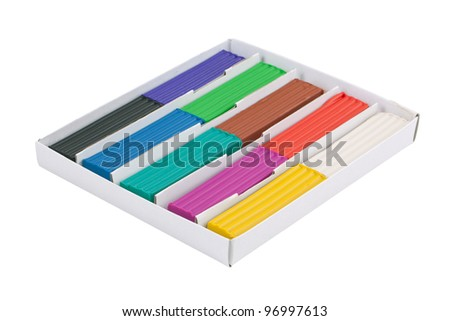 Set of colored plasticine in a box on white background