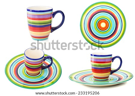 set of colored plates and cups isolated background - stock photo