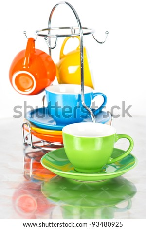 set of colorful cups with reflection. dishware. orange, blue, green, yellow - stock photo