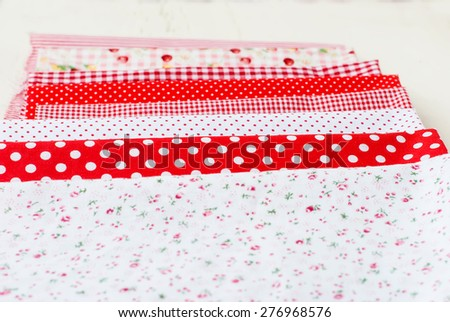 Set of colorful fabrics, spools of thread and scissors. accessories for cutting and sewing - stock photo