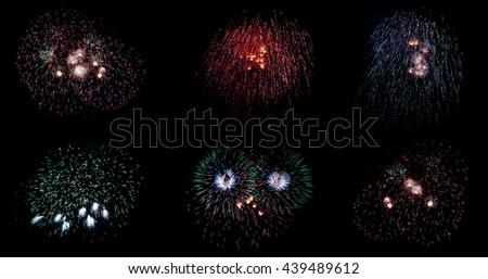 Set of colorful fireworks on black background - stock photo