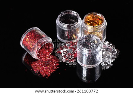 Set of colorful glitter make up. Sequins and rhinestones for nail polish and makeup. - stock photo