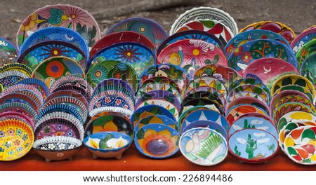 set of colorful painted bowls for sale in Mexican market - stock photo