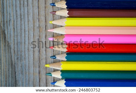Set of colorful pencils on wooden table