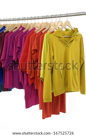 Set of colorful shirt rack on white background