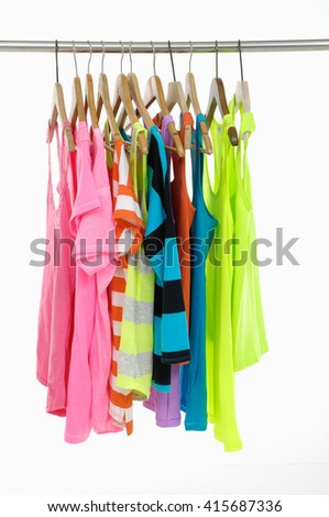 Set of colorful shirt with many peignoir hanging on hangers - stock photo