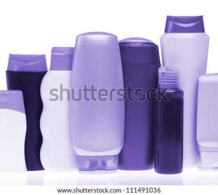 set of cosmetic bottles isolated on white background - stock photo