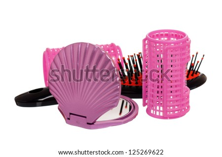 Set of cosmetics - hairbrush, hair curlers and small mirror - stock photo