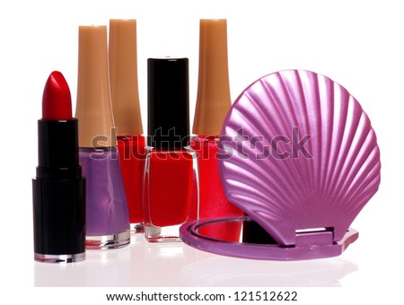 Set of cosmetics - nail polish, small mirror and lipstick isolated on white background - stock photo