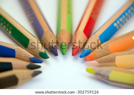 Set of crayons pointing to the center on white background - stock photo