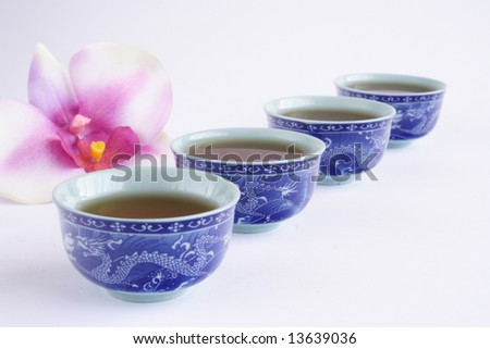 Set of cup of teas in line - stock photo