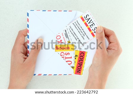 Set of cut coupons for shopping to save money, isolated on white - stock photo