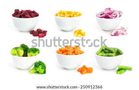 Set of cut vegetables in a bowls isolated on white background