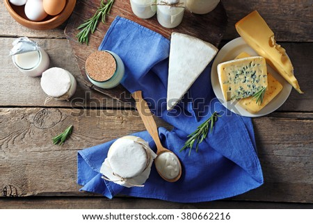 Set of dairy products on wooden table top view - stock photo