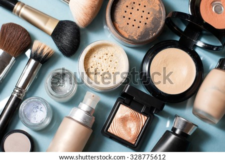 set of  decorative cosmetic powder, concealer, eye shadow brush, blush, foundation