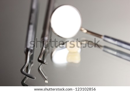 Set of dental tools for teeth care isolated on grey background - stock photo