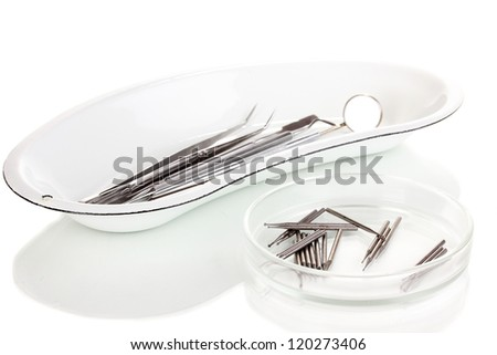 Set of dental tools for teeth care isolated on white - stock photo