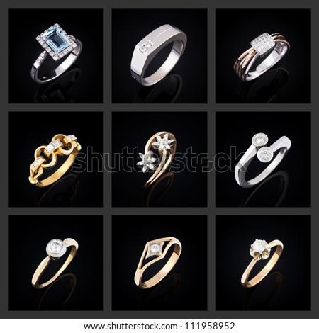 Set of diamond rings on a black background - stock photo