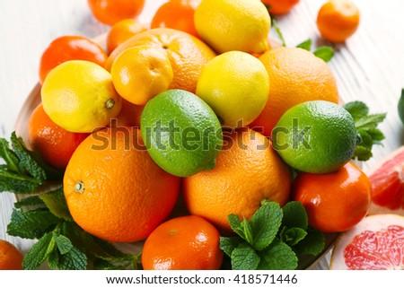 Set of different citrus fruit, close up - stock photo