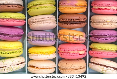 Set of different french cookies macaroons macaroons in a paper box. Top view. Closeup. Coffee, chocolate, vanilla, lemon, raspberry, strawberry, pistachio, violet, rose, orange tastes macaroons - stock photo