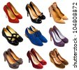 Set of different,multicolored female shoes on a white background.9 pieces. - stock photo