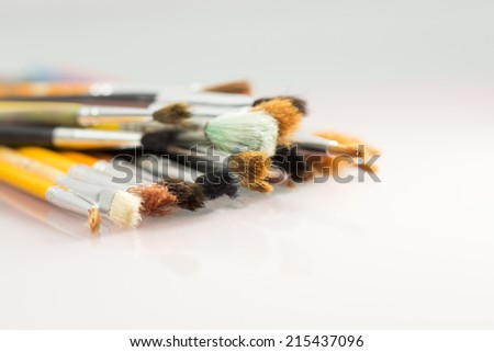 Set of different paintbrushes with white background  - stock photo