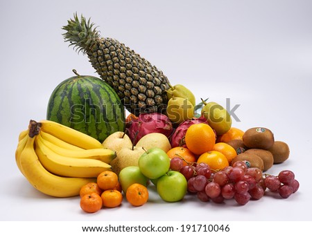 Set of different types of juicy tropical fruits. - stock photo