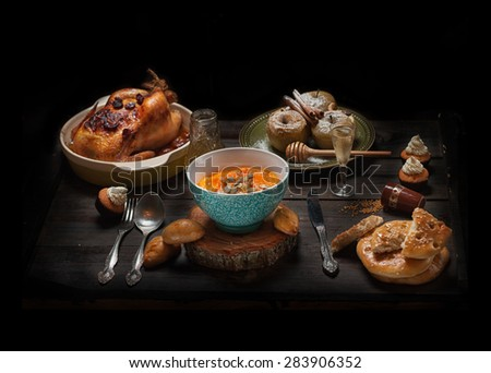 set of dishes with drinks on dark wooden table - stock photo