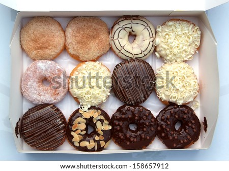 set of donuts in box close up - stock photo