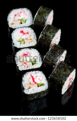 Set of Dragon rolls on a black plate, studio shot - stock photo