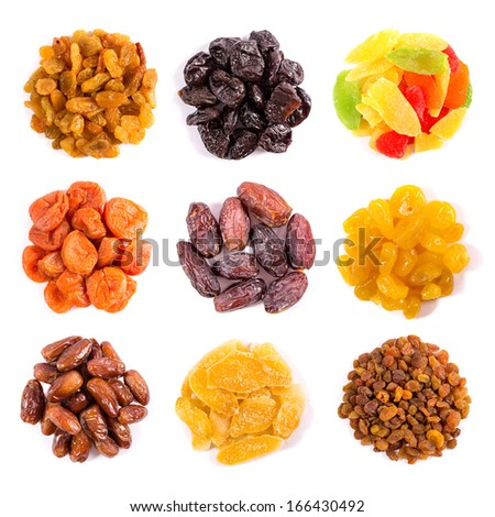 Set of dried fruits isolated on white top view - stock photo