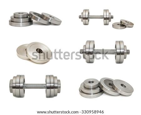 Set of dumbbells on a white background - stock photo