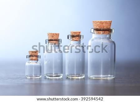 Set of empty glass pharmaceutical phials on dark background - stock photo