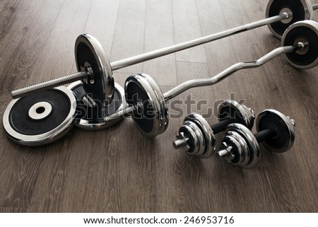 set of equipment for weightlifting: dumbbells and barbells - stock photo