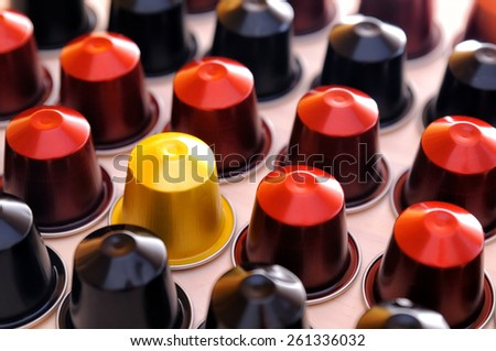 set of espresso coffee capsules for machine aligned diagonally on a table - stock photo
