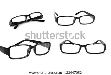 set of eye glasses over white - stock photo