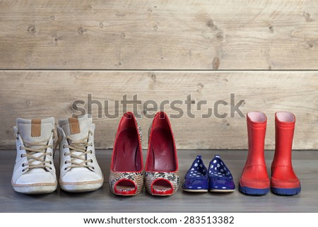 Set of familie shoes standing in line - stock photo