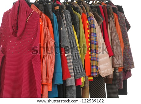 Set of female clothes Variety of hanging on clothes rack
