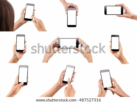 Set of female hands holding black modern cellphone with blank screen at isolated white background.