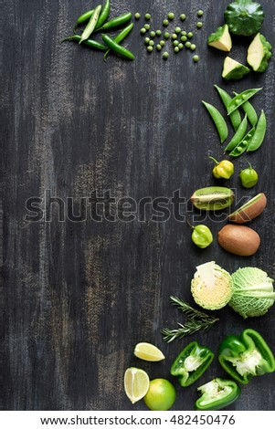 Set of food backgrounds fresh raw green vegetables on dark rustic distressed background,  limes, capsicum, peppers, peas,  kiwi, chilli, habanero, squash