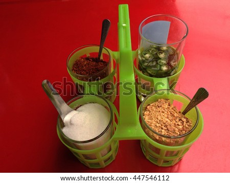 Set of Food Seasoning in glasses, Cayenne Pepper, Sugar and Vinegar, with plastic  spoon - stock photo