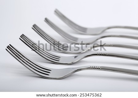 Set of forks on the table - stock photo