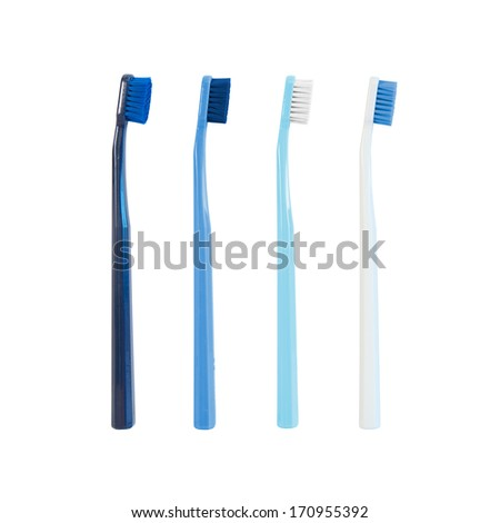 Set of four blue toothbrushes isolated on white background - stock photo