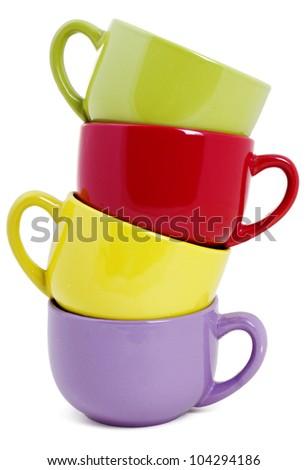 Set of four colorful mugs isolated on white - stock photo