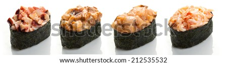 Set of four sushi with octopus, crab, scallop, eel and spicy sauce in nori on a white background close up isolated - stock photo