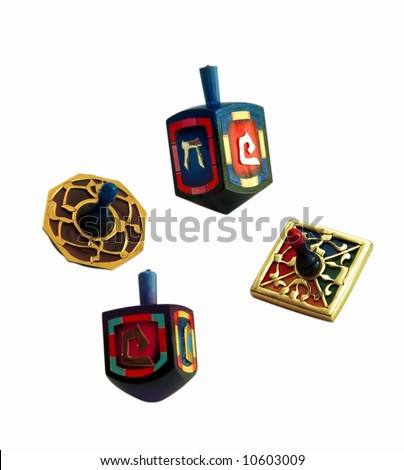 Set of four wooden dreidels. - stock photo
