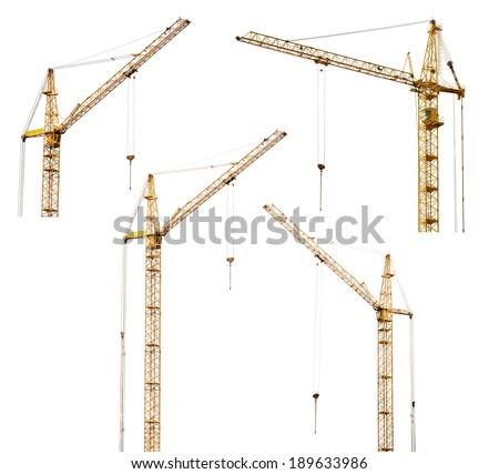 set of four yellow hoisting cranes isolate on white background - stock photo