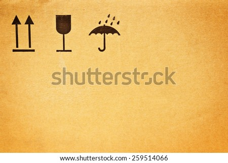 Set of fragile symbols on Cardboard box carton container - stock photo