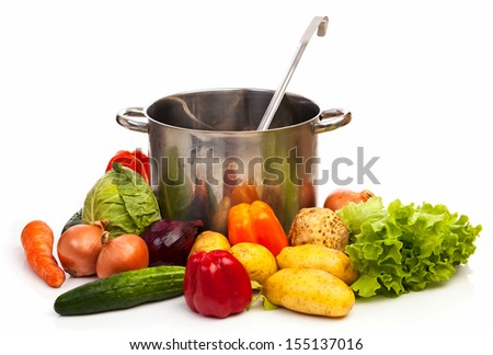 Set of fresh vegetables,casserole and ladle over white - stock photo